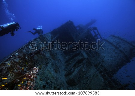 Female technical divers exploring the underwater shipwreck Eagle in the Florida Keys off of Islamorada just south of Key Largo. - stock photo