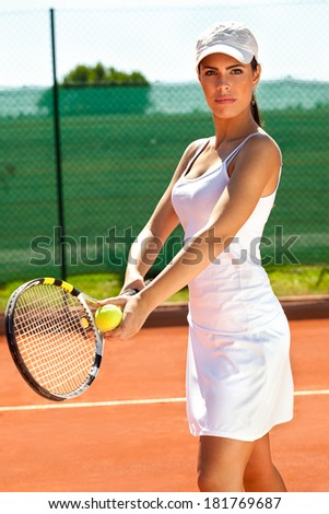 Female tennis player at tennis court - stock photo