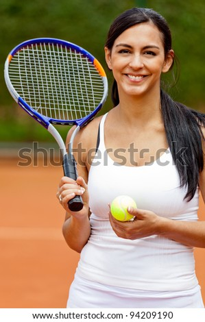 Female tennis player at the clay court smiling - stock photo