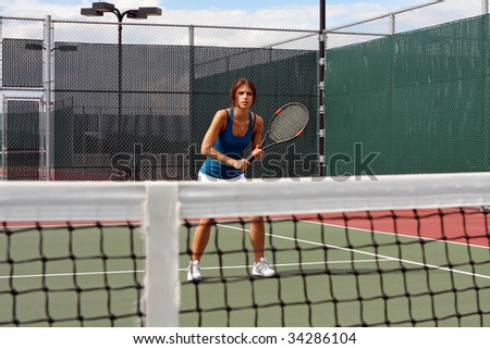 Female Tennis player awaiting a volley - stock photo