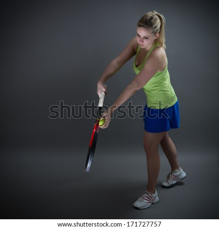 Female tennis player in service position - stock photo