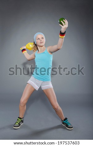 female tennis player with  paprika instead of ball - stock photo