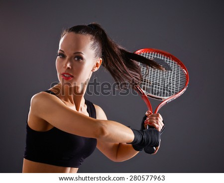 Female tennis player with racket ready to hit a tennis . - stock photo