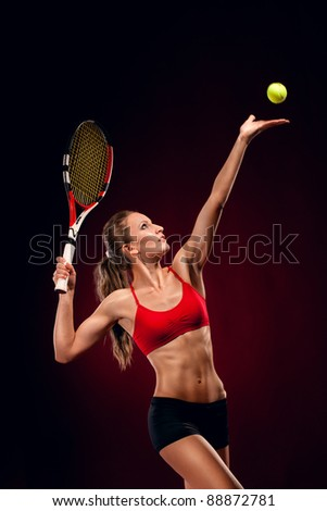 Female tennis player with racket ready to serve a tennis ball - stock photo