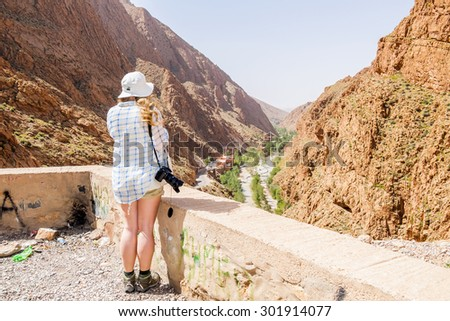 Female tourist admiring view in Dades Gorges, Morocco - stock photo
