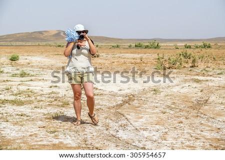Female tourist on desert in Merzouga, Morocco - stock photo