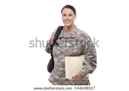 Female US army soldier with documents and backpacks  - stock photo