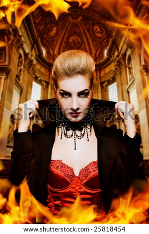 Female vampire in a burning church - stock photo