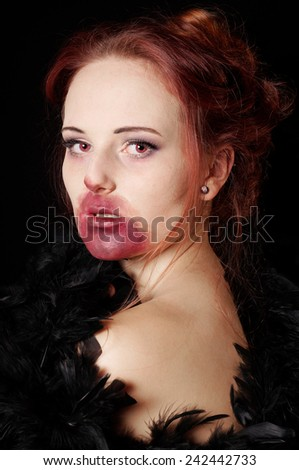 female vampire or zombie portrayed as a glamorous vamp - stock photo