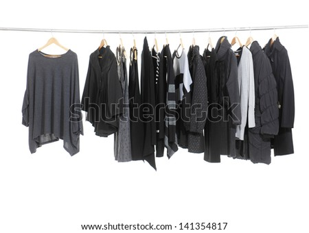 Female Variety of clothes hanging on the rack - stock photo