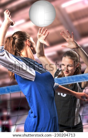 female volleyball players with a ball - stock photo