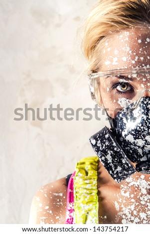 Female wearing a respirator - stock photo