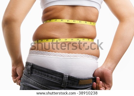Female wearing jeans that already too small for her, concept to have diet - stock photo