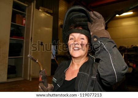 Female welder - stock photo