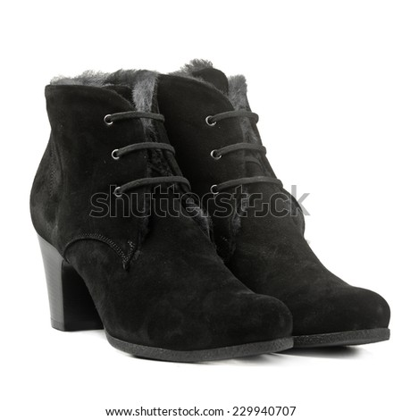 Female winter suede boots isolated on white background - stock photo