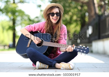 Female with guitar - stock photo