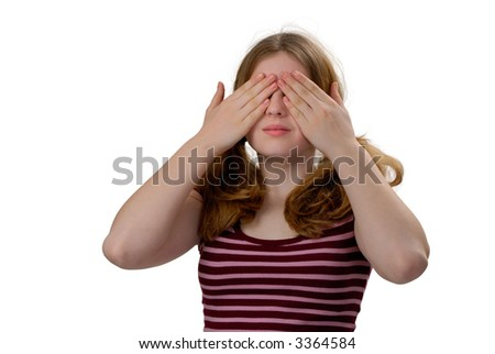 Female with her hands covering her eyes, See No Evil - stock photo