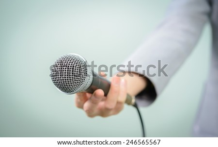 female with microphone, close up - stock photo