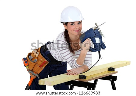 female woodworker smiling - stock photo