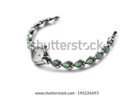 Female wristwatch on silver bracelet isolated over white - stock photo