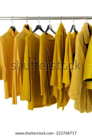 female yellow clothing on display  - stock photo