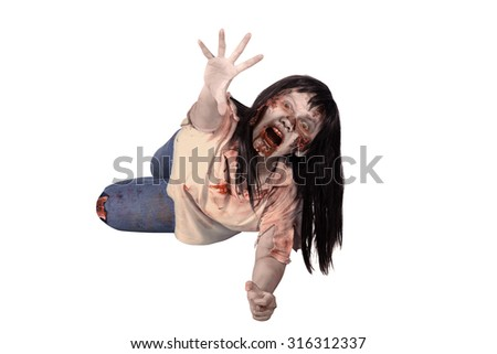 Female zombie crouching on the floor isolated over white background - stock photo