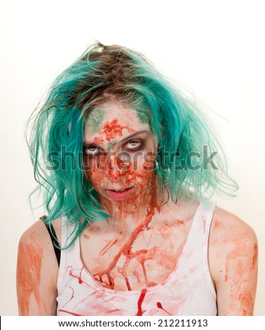Female zombie staring at the viewer anticipating her next victim - stock photo