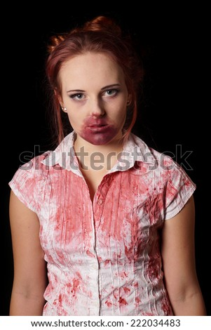 female zombie with blood splatter - stock photo