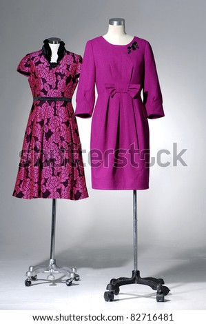 Females red dress on two mannequin isolated - stock photo