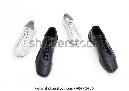 Feminine and male gym shoes. Conceptual photo expressing relations between two people. - stock photo