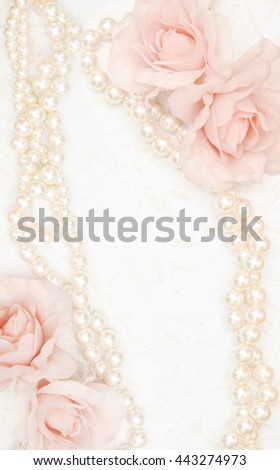 Feminine background with roses and pearls - stock photo