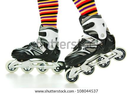 Feminine legs with roller skates on a white background. - stock photo