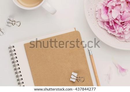 feminine minimalist notebook mock-up with coffee mug, pencil and peonies - stock photo
