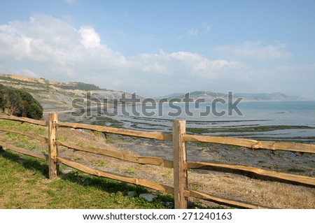 Fence above seafront at Lyme Regis, Dorset - stock photo