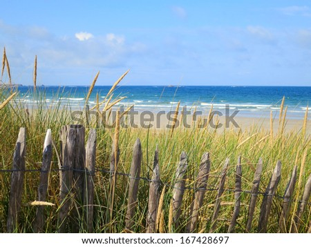 Fence at the beach of Quiberon, Brittany, France - stock photo