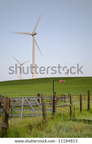 fence field and windmills - stock photo