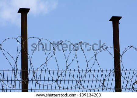 fence from barbed wire - stock photo