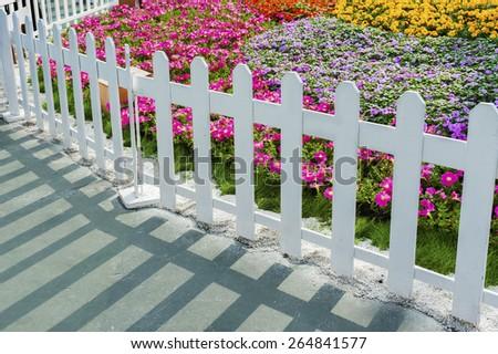 Fence in Flower garden - stock photo