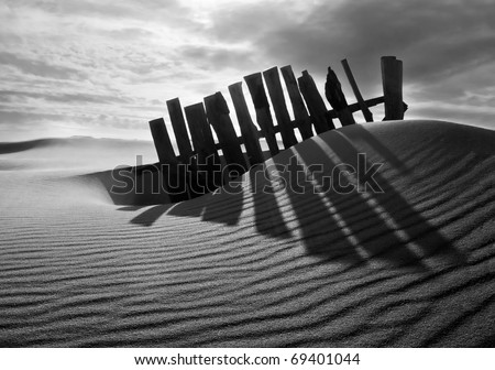 fence is in the sand - stock photo