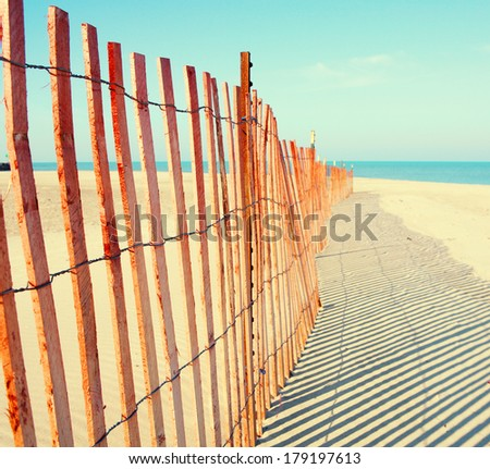 Fence on the beach - stock photo