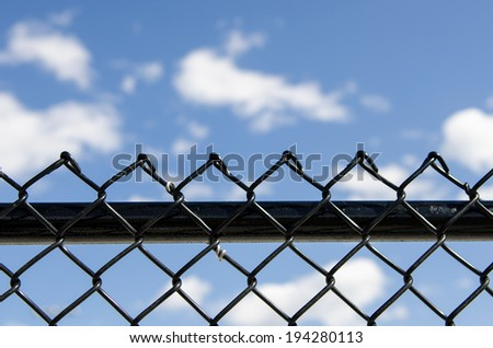 fence outside with blue sky - stock photo