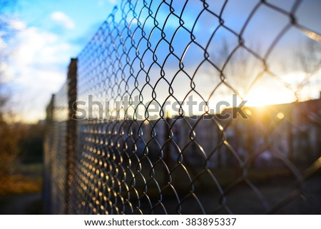 fence with metal grid in perspective - stock photo