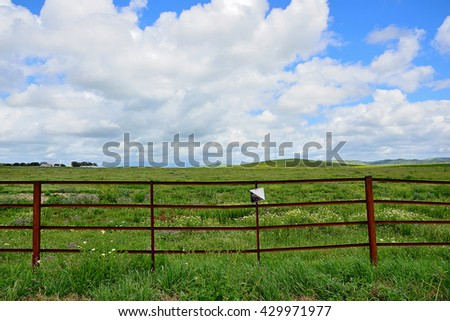 fenced field - stock photo