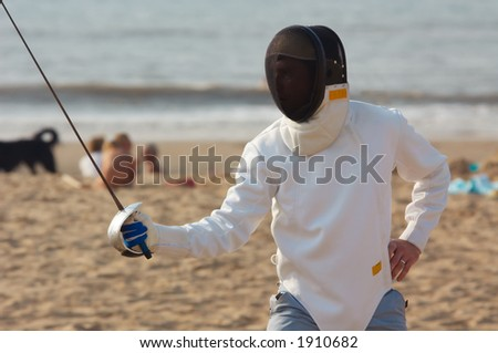 Fencing on the beach - stock photo