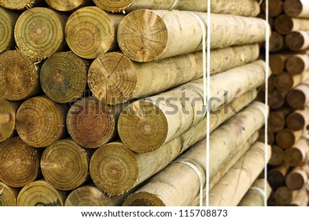 fencing posts on a pallet at a sawmill - stock photo