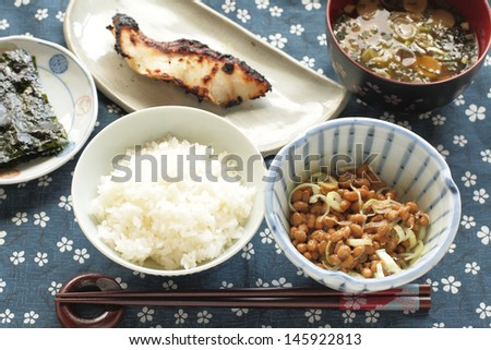Fermented soybeans Natto,  boiled rice, grilled fish and miso soup - stock photo