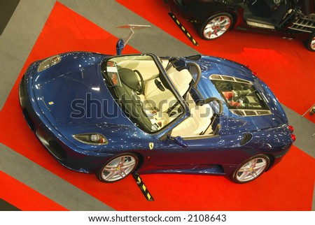 Ferrari Spider sportscar on display at car show - stock photo