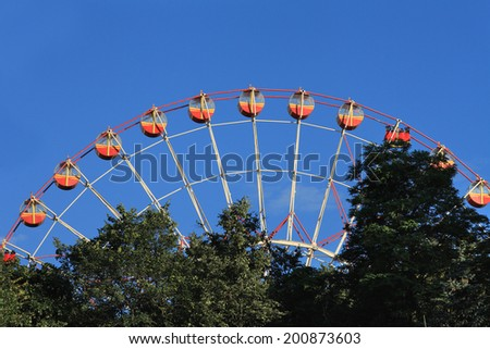 Ferris Wheel against blue sky. - stock photo