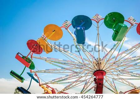 ferris wheel against blue spring sky - stock photo