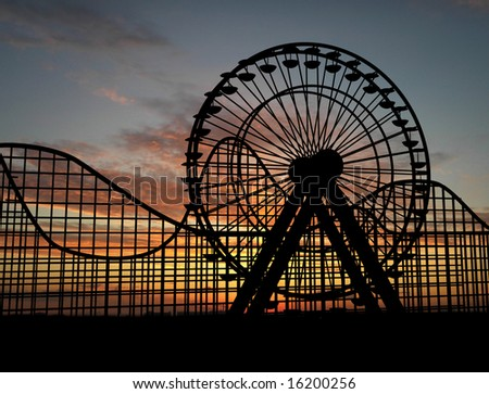 Ferris wheel and amusement park - stock photo
